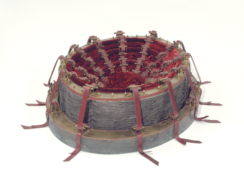 "Cathy de Monchaux, ""Red"", 1999; Brass, copper, velvet, leather, canvas, steel, graphite, and thread; 14 x 46 x 34 in.; Gift of Heather and Tony Podesta Collection, Washington, DC"