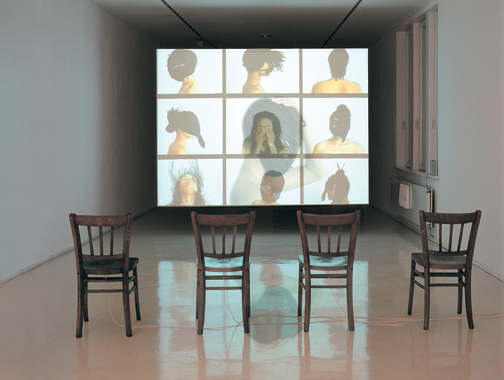 Mwangi Hutter, Neger Don't Call Me (installation view), 2000; DVD, speakers, four wood chairs, and Dolby surround sound; National Museum of Women in the Arts, Gift of Heather and Tony Podesta Collection, Washington, D.C., Image courtesy of the artists