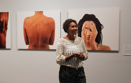 Ingrid Mwangi at NMWA on June 6, discussing Mwnagi Hutter's video installation and (background) photographic series Shades of Skin