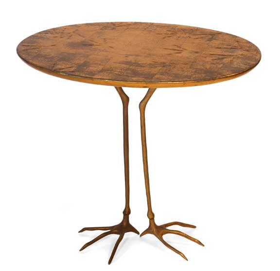 Table with Bird's Feet, 1983; Top: wood, carved and goldplated; feet: bronze, 25 1/2 x 27 1/2 x 19 3/4 in.; On loan from Daphne Farago Collection, Delray Beach, Florida; Photograph by Suzanne Khalil; Image courtesy of Lisa Wenger and Martin A. Bühler, Meret Oppenheim Estate
