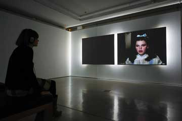 Soda_Jerk, After the Rainbow, 2009; 2-channel projection on screens back-lit with fluorescents (Installation view at UTS Gallery, Sydney, 2013); Image courtesy of the artists; Photo David Lawrey