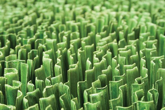 Dawn Holder, Monoculture (detail), 2013; Porcelain, 2 1/2 x 92 x 176 in.; Courtesy of the artist