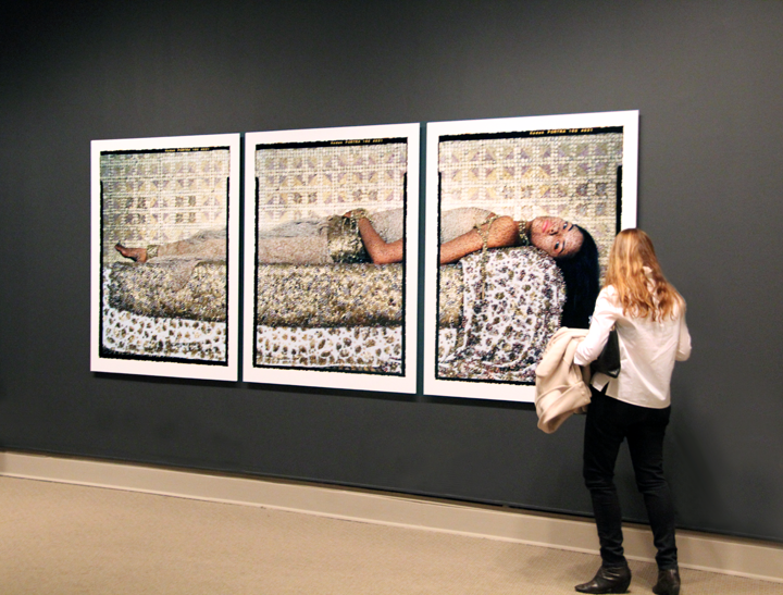 A visitor studies Lalla Essaydi's Bullets Revisited #3 (2012)
