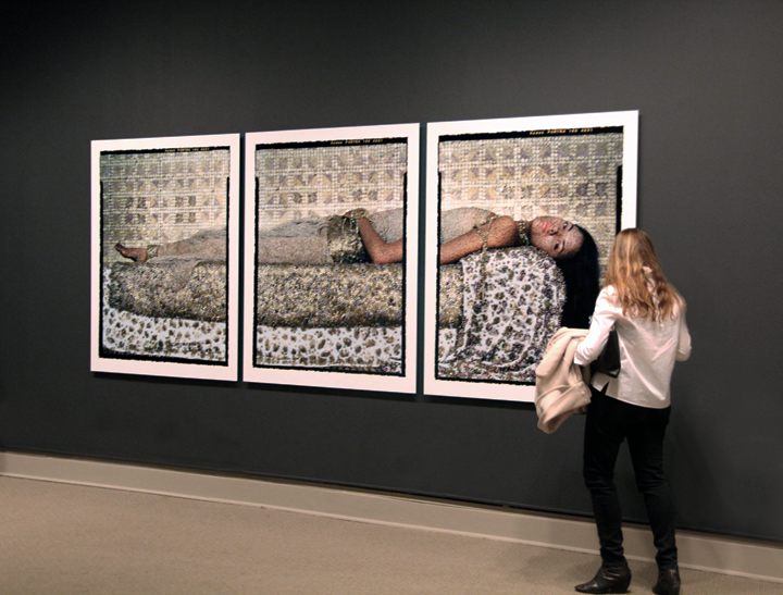 A NMWA visitor studies Lalla Essaydi's work in She Who Tells a Story