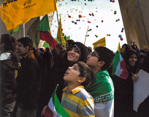 "Najieh and her two sons during a parade celebrating the thirty-fifth anniversary of the Islamic Revolution in Freedom Square, February 11, 2014"" (146)."