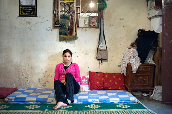 """Rania Matar, Mariam, Bourj al Shamali Palestinian Refugee Camp, Tyre, Lebanon, from the series """"A Girl and Her Room,"""" 2009; Pigment print, 36 x 50 in.; Courtesy of the artist and Carroll and Sons, Boston; © Rania Matar"""