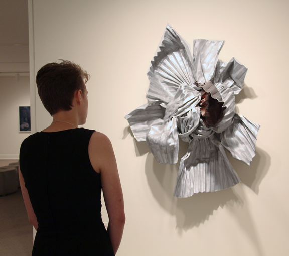 A visitor gazes at Lynda Benglis's Eridanus at NMWA