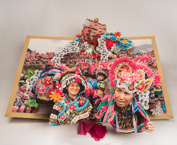 "Colette Fu, Yi Costume Festival, from the series ""We are Tiger Dragon People,"" 2008–14; Artist's book with color prints, yarn, and Chinese brocade fabric, 32 x 31 x 9 in. (open); Courtesy of the artist"
