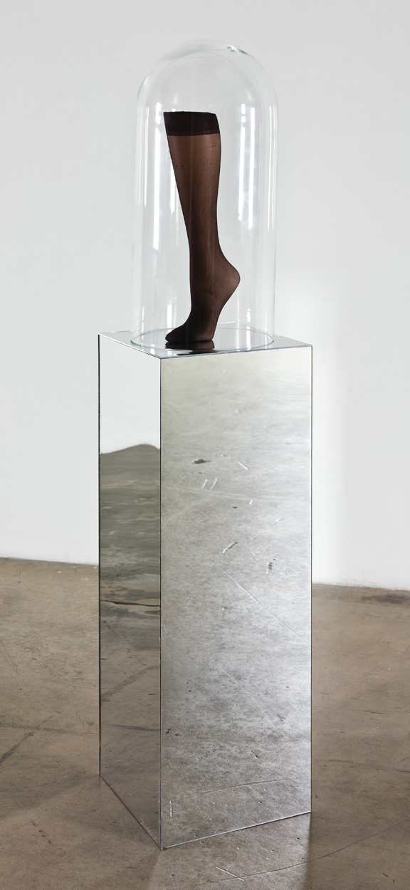 Josephine Meckseper, American Leg, 2010; Mannequin leg, hosiery, glass, and mirror; Rubell Family Collection, Miami