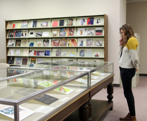 A visitor studies broadsides in the NMWA Library and Research Center; Photo: Francesca Rudolph, NMWA