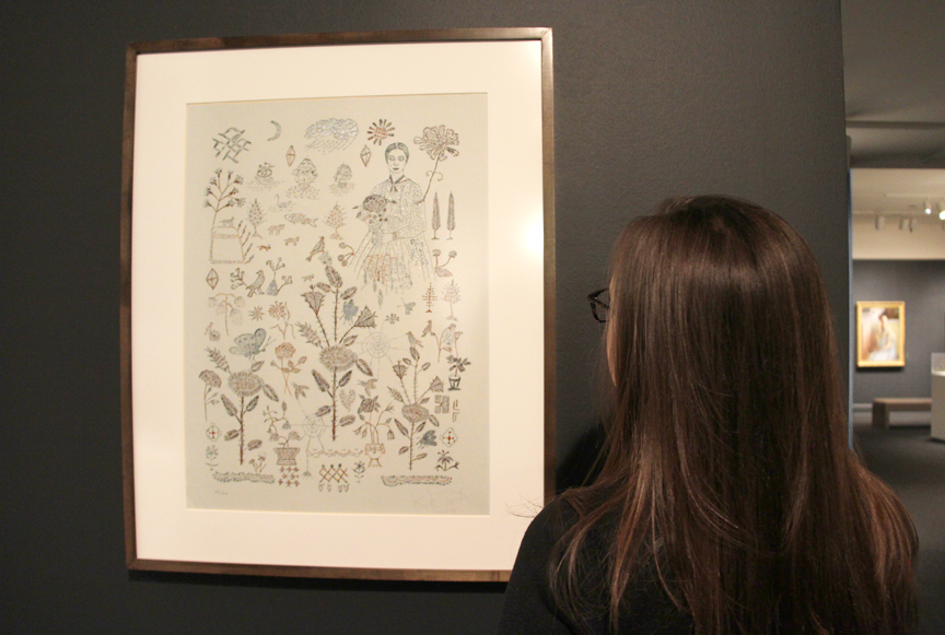 A visitor studies Kiki Smith's Sampler, 2007 on view in NMWA's collection galleries