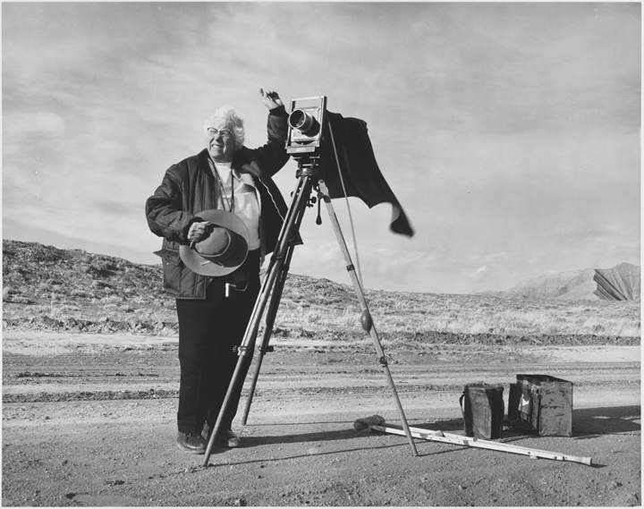 Fred E. Mang, Jr.,Laura Gilpin taking photographs along dirt road, 1971; Reproduction of gelatin silver print; Amon Carter Museum of American Art, Fort Worth, Texas, Gift of the artist and Laura Gilpin P1979.98; ©1971 Fred E. Mang, Jr.