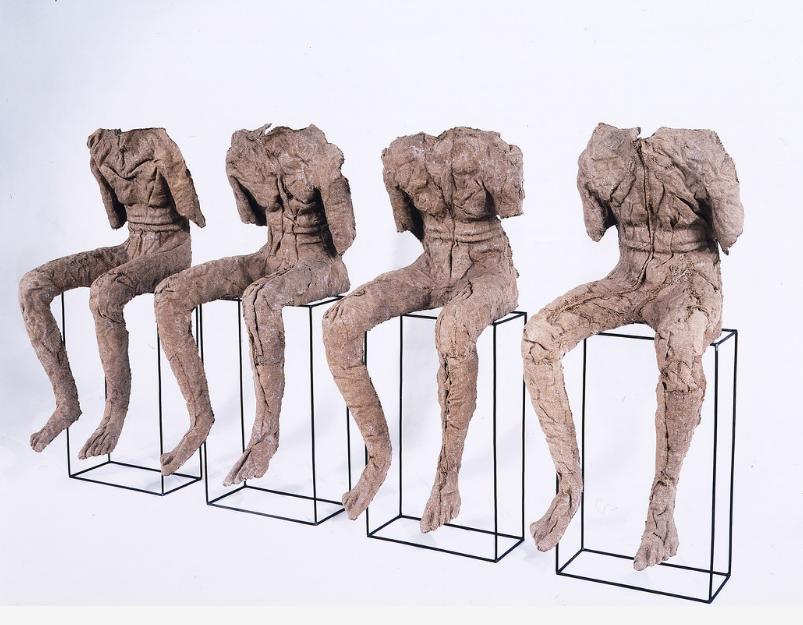 Magdalena Abakanowicz, 4 Seated Figures, 2002; Burlap, resin, and iron rods, 53 1/2 x 24 1/4 x 99 1/4 in.; National Museum of Women in the Arts; © Magdalena Abakanowicz