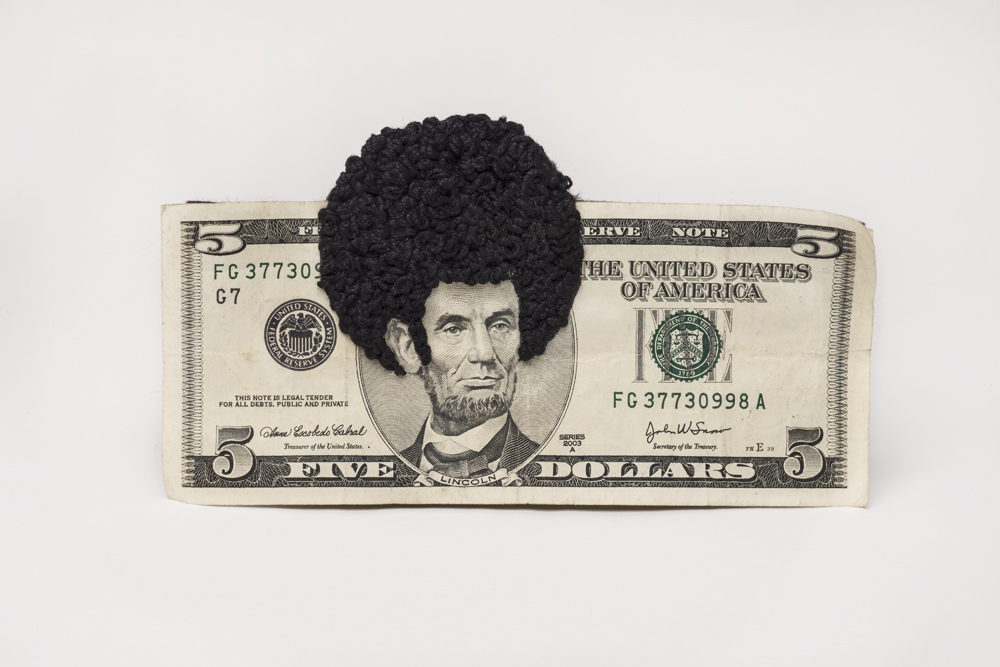 Artwork showing $5 bill, with an embroidered Afro on Abraham Lincoln