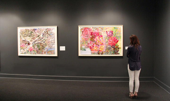 NMWA visitor gazes at Barbados (left) and Bronzed Roses (right); Photo: Madeline Barnes, NMWA