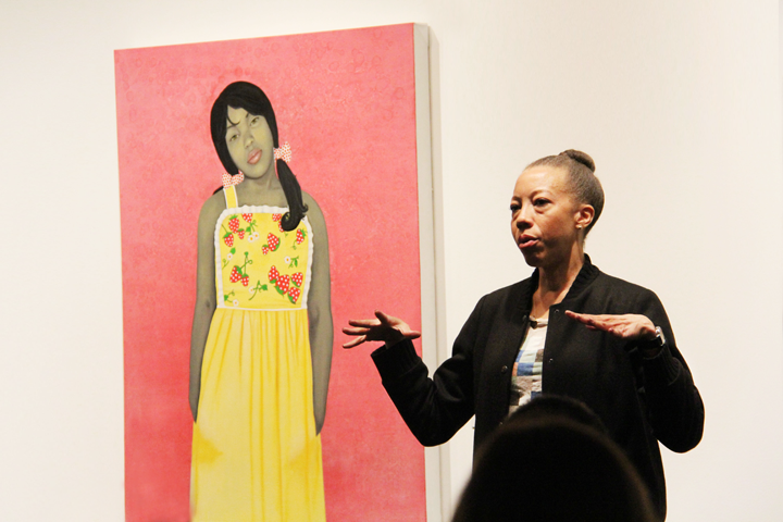 Amy Sherald in front of her work at NMWA; Photo: Emily Haight, NMWA
