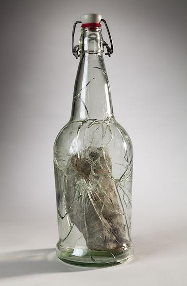 Lenka Clayton, Rock inside bottle smashed by rock inside bottle smashed by rock, 2016, bottle, rock, glue; Photo by Tom Little