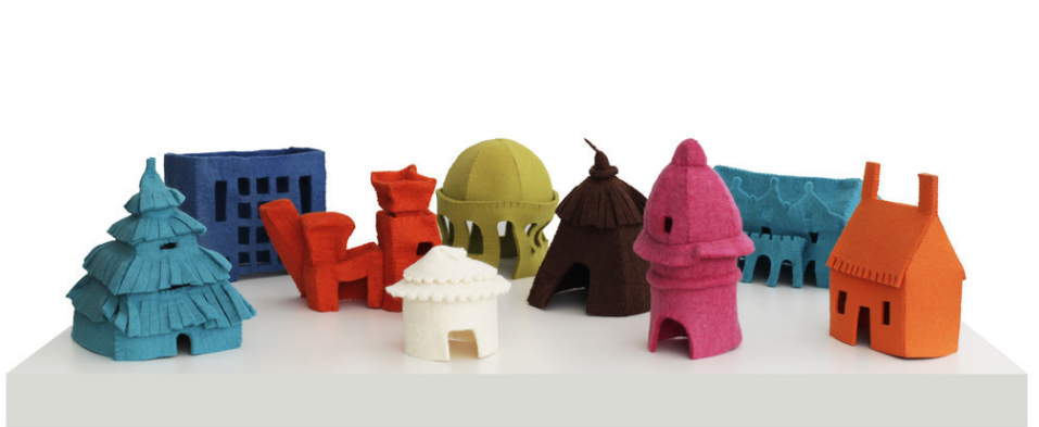 A row of multi-colored felt houses of different styles.