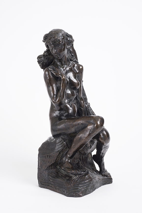 Camille Claudel's bronze sculpture depicting a naked young girl sitting on a rock with her right hand resting on her chest as she looks down toward the left.
