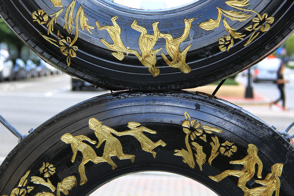 Betsabeé Romero, Huellas y cicatricez (Traces and scars) (detail), 2018; Four tires with engraving and gold leaf and steel support, approx. 192 1/2 x 86 5/8 x 9 3/4 in.; Courtesy Betsabeé Romero Art Studio; Photo by Mara Kurlandsky, NMWA