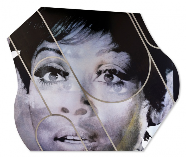 Mickalene Thomas's piece Diahann Carroll #2, a closeup of a black woman's face in grey-scale.
