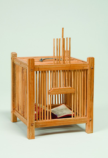 Elisabetta Gut, Book in a Cage, 1981; Wood, wire, and French-Italian pocket dictionary, 7 1/2 x 4 5/8 x 4 5/8 in.; National Museum of Women in the Arts, Gift of the artist; © Elisabetta Gut
