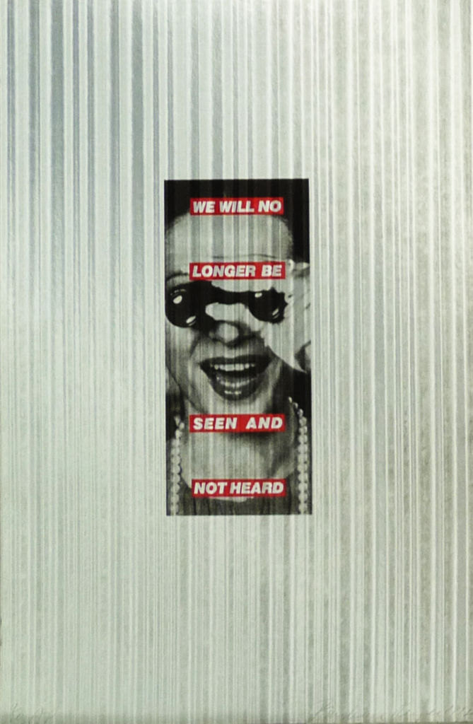 In Untitled (We Will No Longer Be Seen and Not Heard) (1992), currently on view at NMWA, Kruger plays with the gendered dichotomies of passivity and activity. The piece comprises a photograph printed on aluminum, overlaid with lines of text in white-on-red strips. The picture is cropped tightly on the face of a laughing woman. She holds what appears to be opera glasses and looks through them at the viewer. The statement, printed in bold letters, suggests that women want to be the makers of their own image.