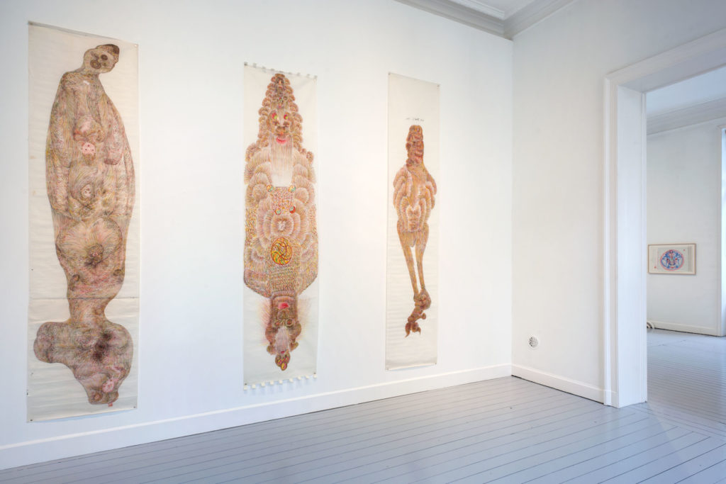 Three of Guo Fengyi's intricate drawings hang on the white walls of the Gladstone Gallery--they are very tall, possibly 7 or 8 feet, and done in earthy, warm color tones. The figures resemble hybrids between animals, monsters, and/or humans.