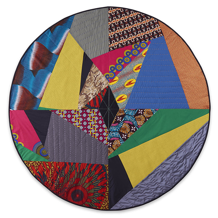 A circle that contains different patterned and shaped cuts from various quilts.