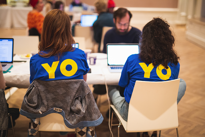 "Two female participants at the Jewish Museum's March 3, 2019, Wikipedia-Edit-a-thon, wearing ""OY/YO"" t-shirts--the photos shows them from the back."