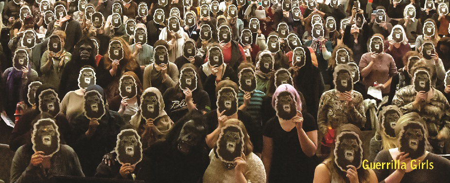 A wide-angle shot of hundreds of women holding up Guerrilla Girls masks in front of their faces