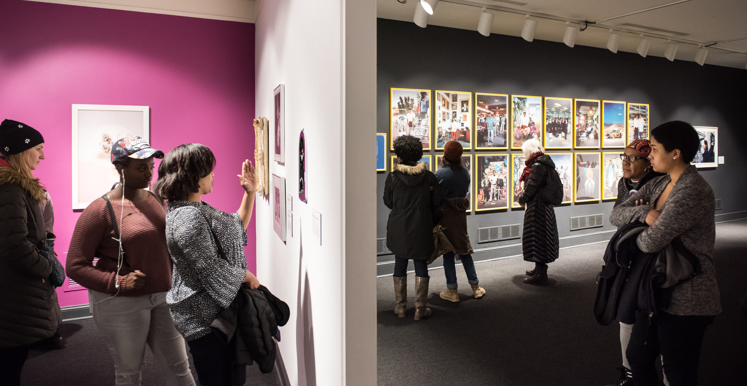 Eight diverse women museum visitors are scattered throughout the NMWA collection galleries browsing the art on the walls.