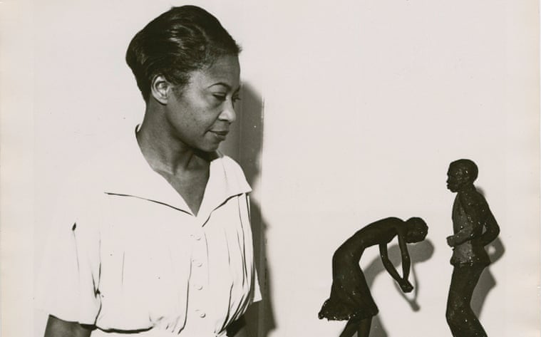 Augusta Savage viewing two of her sculptures, Susie Q and Truckin, 1939; Photo courtesy of the Schomburg Center for Research in Black Culture