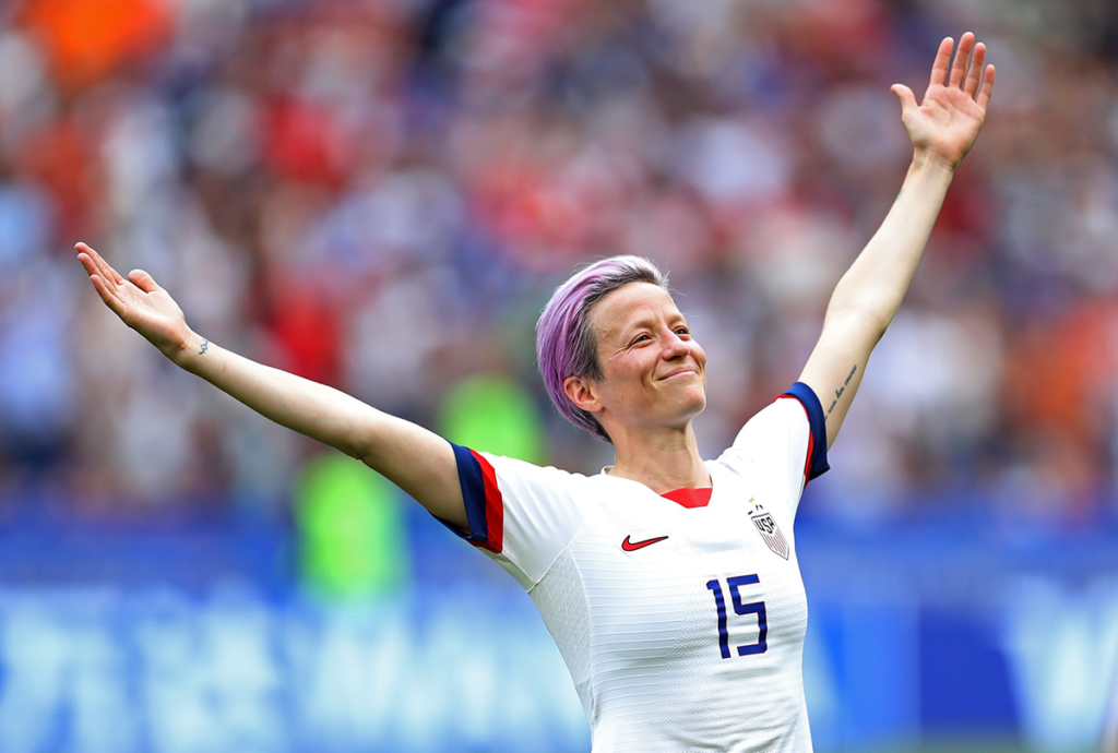 Megan Rapinoe, captain and star of the U.S. Women's National Team, celebrates with her arms up in the air after scoring the opening goal in the World Cup final