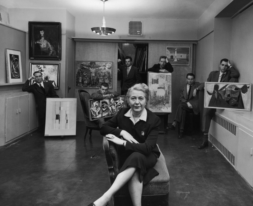 Edith Halpert at her Downtown Gallery, in a photograph for Life magazine in 1952; She is joined by some of the new artists she was promoting that year: Charles Oscar, Robert Knipschild, Jonah Kinigstein, Wallace Reiss, Carroll Cloar, and Herbert Katzman