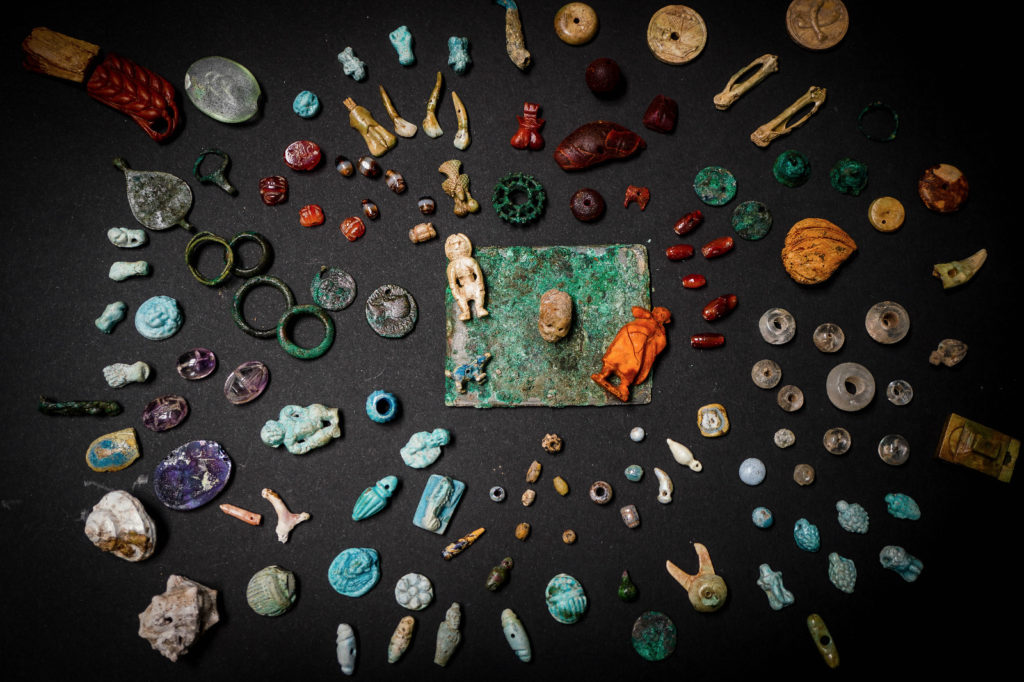 More than 100 miniature dolls, phallic amulets, necklace beads, and a tiny skull among other objects made of bone, bronze, glass, and amber were uncovered at Pompeii.