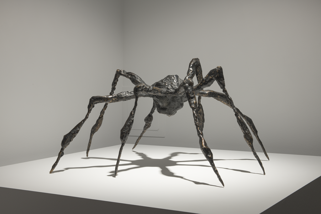 A bronze sculpture of a spider.