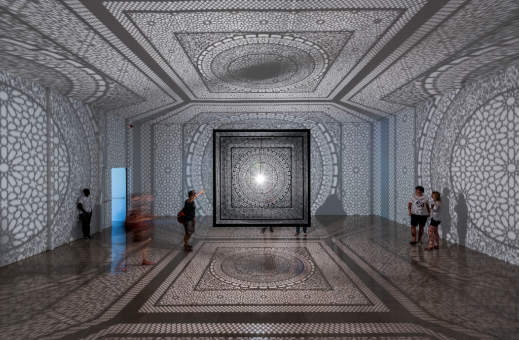 People experience Anila Quayyum Agha's installation Intersections, 2013; Site-specific installation at Rice University Art Gallery, 2015