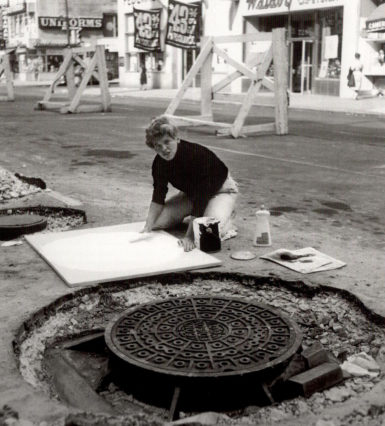 Gillian Jagger in New York, 1964; The artist crouches above a white canvas and sculptural piece in process