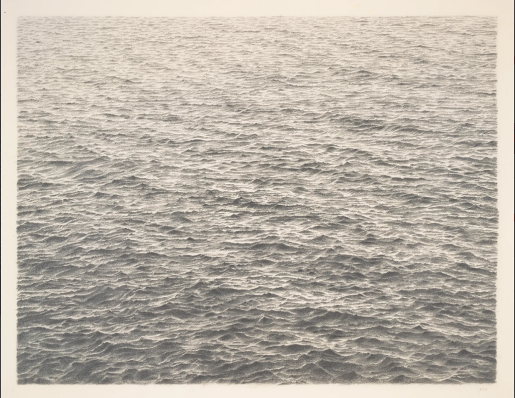 A black and white photo of a still ocean.
