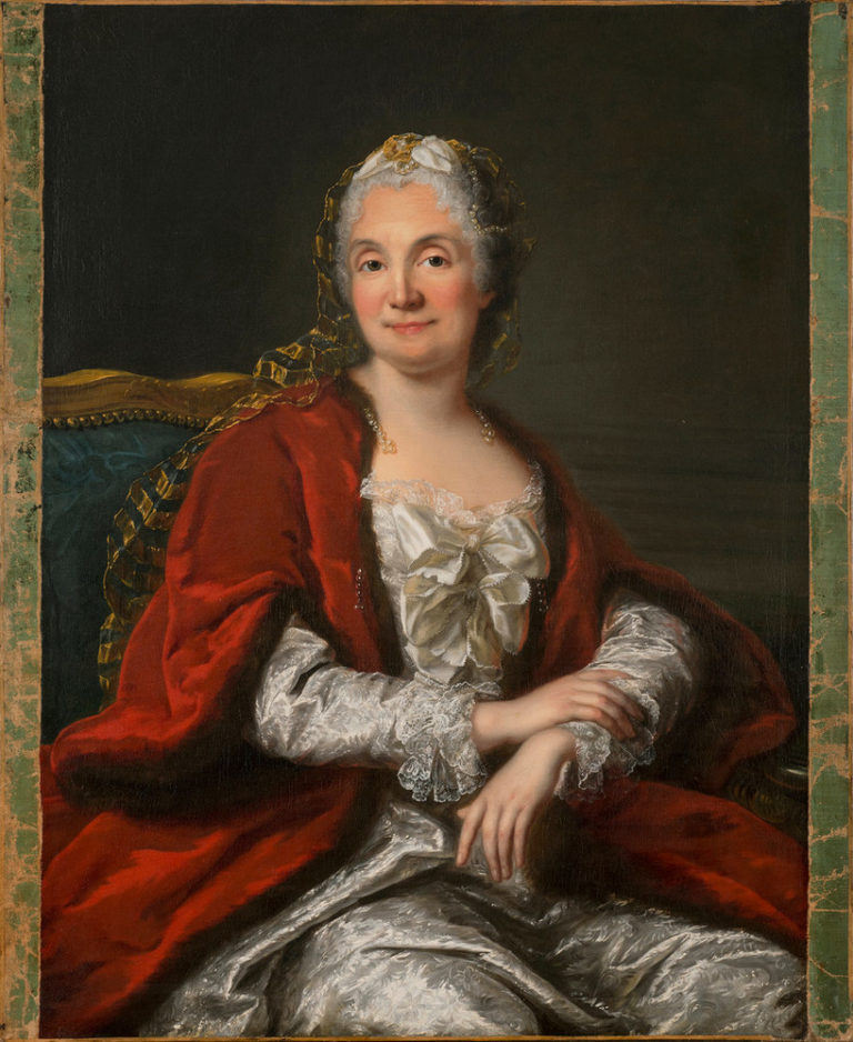 A light-skinned, gray-haired woman appears from the waist up, sitting with arms crossed loosely in her lap. Her body turns to her left, but she faces the viewer offering a slight smile and making eye contact. Her white satin gown and fur- and pearl-trimmed red cape imply wealth.