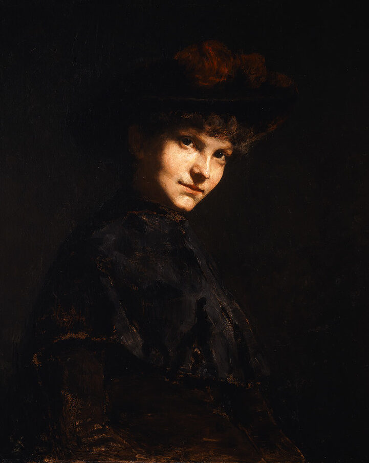 Realistic half-portrait of a light-skinned woman, set against a dark background, with her face brightly illuminated as she gazes directly at the viewer. She is clad in dark Victorian dress with her hair pinned up under a hat adorned with a red velvet bow.