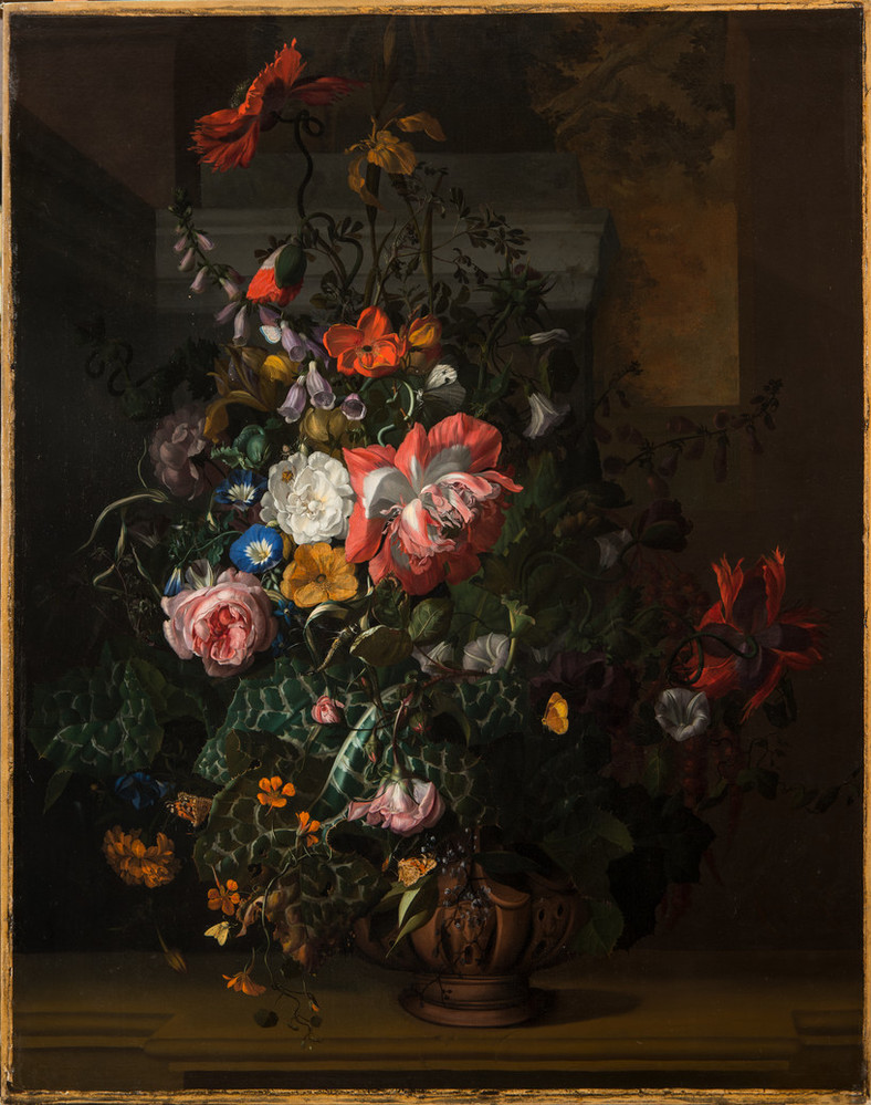 An elaborate floral arrangement painted with precise detail appears dramatically spot lit against a dark background. Large red and pink blooms dominate, interspersed with small yellow, white, and blue blossoms and varied foliage. Moths and other insects animate the bouquet.