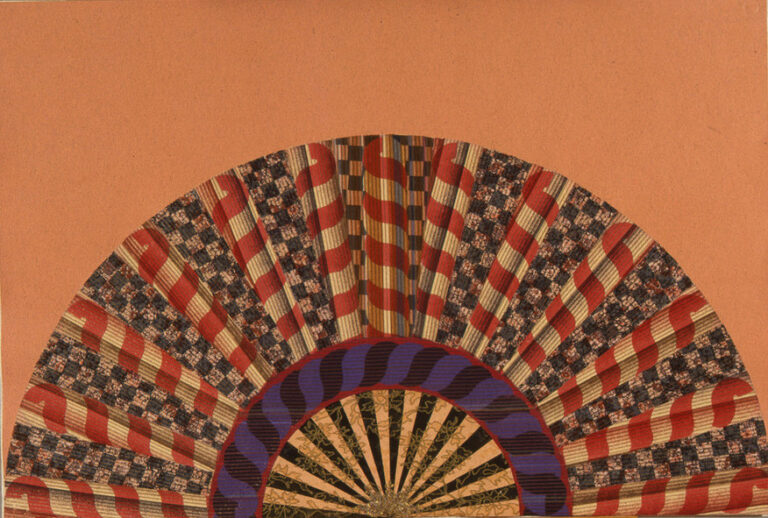 A colorfully painted and collaged folding fan spread open on a peach-orange background.
