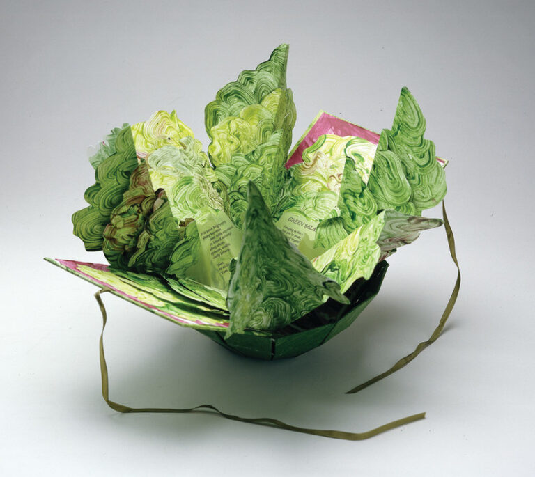 Artist's book resembling a salad in a bowl. Constructed of Tyvek that has been painted in swirling greens and map-folded to look like leaves of lettuce, there is poem written on the inner the leaves.