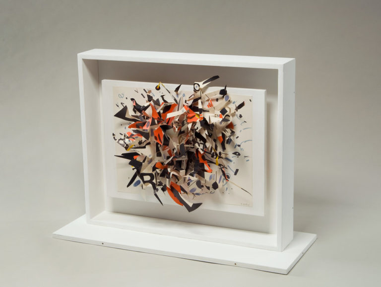 A three-dimensional collage explodes into space with cut-out shapes of black, red, white and blue. Concentrated in the center, the piece dissipates towards the edges, with a bird's head peeking out of the morass towards the top. The canvas floats within a larger, white frame.