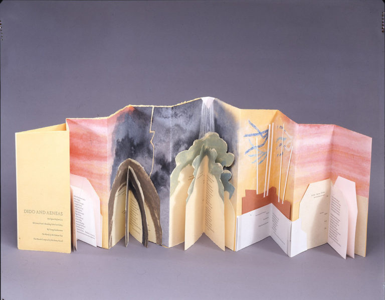 Accordion book of peach paper. Blocks of text, in geometric and organic-shaped boxes, occupy the lower half of the pages. Each block of text has additional folds, forming a mini-book. Above, warm colors fade into dark skies, trees, and ship masts, and then again into pink tones.