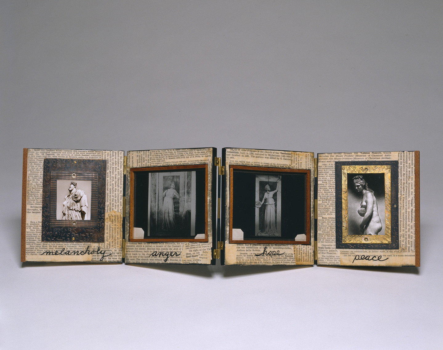 An open accordian-style book with four panels. On each panel is newsprint over which is a black and white photograph of a person. Under each figure is written, from left to right: melancholy, anger, hope, peace.