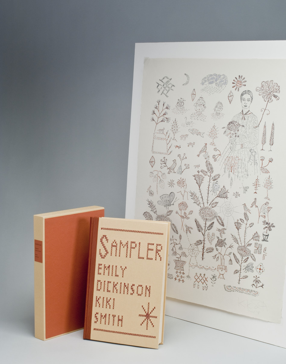 A beige book with orange binding and text in needlepoint on cover that reads,