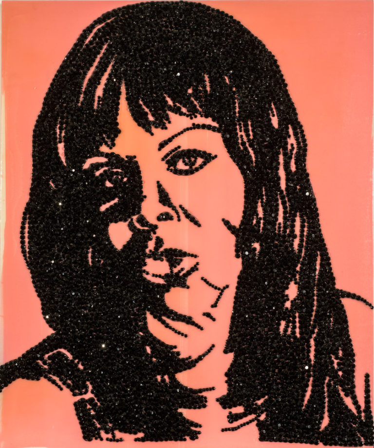 A mixed-media artwork renders the contours of an African American woman's facial features, shoulders, and long, straight hair in black rhinestones on a glossy, bubble-gum pink panel. The woman faces forward, gazing outward. Some rhinestone facets glint with reflected light.